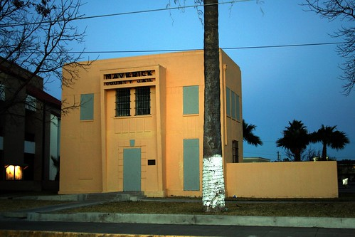maverick county jail at sundown with flash