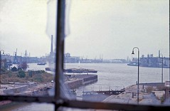 From Wapping 13 Oct 1973: down the Thames from Shadwell basin lock (JB photographer) Tags: china city chimney usa london thames docks 35mm river dock asia decay bank explore credit docklands longevity re canarywharf household hsbc rotherhithe 1973 powerstation wapping loan banking worldtrade limehouse finance mortgage eastlondon 1000views stepney shadwell deposit lockgate recession isleofdogs towerhamlets bankers g20 juxtaposed liquidity topcon emergingmarkets midlandbank aldinger balancesheet thecameraneverlies economicgrowth negativeequity creditcrunch globalrecession bankingcrisis copyrightjonathanbarkerphotographer globaleconomiccrisis lacrise rightsissue