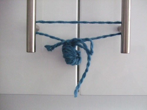 Cupboards closed with yarn tie