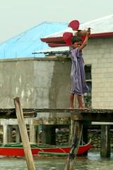 inusara (Farl) Tags: travel sea broken colors girl shirt airplane toy boat wooden muslim philippines flowing propeller stilts mindanao tawitawi samal simunul tubigindangan armm