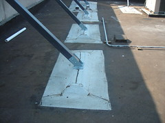 Encapsulated sleeper support with modified bitumen boot flashings at the corners.