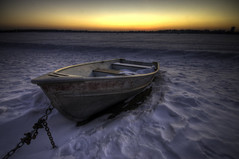 Shackled (Greg Benz Photography) Tags: winter sunset lake snow cold ice minnesota photography benz frozen nikon calhoun cities minneapolis twin rowboat twincities hdr gettyimages frozenlake frozentundra lakecalhoun supershot anawesomeshot winterhdr carbonsilver gregbenz gbenz twincitieshdr minneapolishdr twincitieswinter