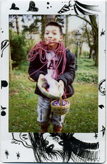 cole (golfpunkgirl) Tags: boy cute smile garden polaroid cole rope eggs fujifilm cheki instaxmini easterloot yonexchekifilm