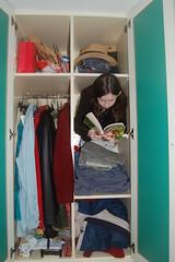 Closet Bookworm ? (fitzinthehome) Tags: closet d50 reading book nikon books bookshelf humour clothes shelf bookshelves shelves bookworm