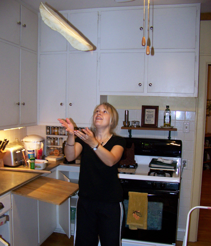 Tossing pizza in our kitchen