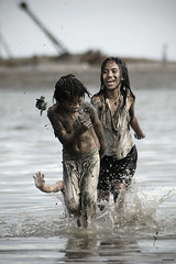 Hiding Tears. (kamalayan) Tags: poverty friends sea water children fun warf friendship mud philippines dreary run irony bleak bacolod splash putik explored kamalayan reuelmarkdelez banago
