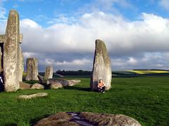 PJ in the ... brrr... sun (pjink11) Tags: england europe olympus 2006 stonehenge prehistoric thegirls monoliths stoneage e500 zd1445mm