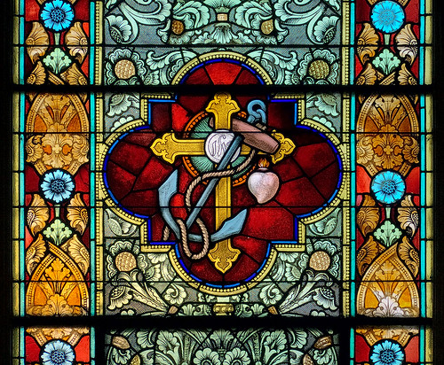 Saint Peter Roman Catholic Church, in Saint Charles, Missouri, USA - stained glass window of cross and anchor