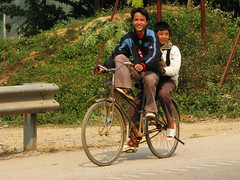 Who's Riding the Bike? (Life in AsiaNZ) Tags: road friends two boys bike bicycle canon g powershot vietnam riding together series   g9 gseries sametime  canong9 lifeinnanning flickrgiants