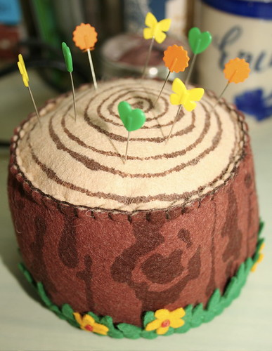Tree stump pin cushion
