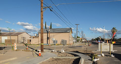 """At """"about the time that Tombstone, Arizona, was at its rip-roaring, wild, woolliest worst"""" — i.e. Oct. 2015!! (Tim Kiser) Tags: 2015 20151009 arizona arizona80 arizonahighway80 arizonaroute80 arizonastateroute80 arizonalandscape cochisecounty cochisecountyarizona highway80 img0548 october october2015 route80 statehighway80 stateroute80 tombstone tombstonearizona tombstonelandscape tombstonestreetscape us80 ushighway80 usroute80 buildings cautiontape construction constructionarea constructionlandscape constructionsite constructionsitelandscape constructionzone dirt distantpalmtree electriclines electricpoles eveninglandscape eveningsun formerus80 formerushighway80 formerusroute80 landscape mostlysunny overheadelectriclines overheadpowerlines plasticcautiontape powerlines roadwork roadworkzone sidewalk sidewalkclosed sidewalkconstruction southarizona southeastarizona southeasternarizona southernarizona streetscape telephonepoles tornup trafficcones utilitypoles view yellowcautiontape unitedstates us"""