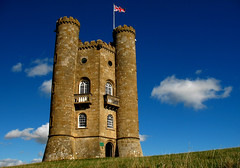 Flying the flag V1 (Rich007) Tags: uk greatbritain blue sun sunlight tower monochrome stone clouds countryside europe day unitedkingdom britain flag country hill gothic broadway clear gb worcestershire unionjack unionflag cotswold worcs 1799 broadwaytower thecotswolds abigfave betterthangood
