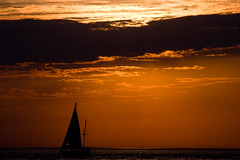 BU830 Sunset and Sailboat (listentoreason) Tags: sea sky orange usa color beach water clouds america canon newjersey ship technology unitedstates random scenic places event transportation capemay activity sailingship sunsetsunrise score50 ef28135mmf3556isusm