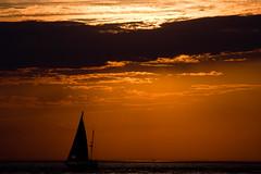 BU830 Sunset and Sailboat (listentoreason) Tags: sea sky orange usa color beach water clouds america canon newjersey ship technology unitedstates random scenic places event transportation capemay activity sailingship sunsetsunrise score50 ef28135mmf3556isusm