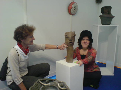 Sandrine Lepelletier showing a ceramic to a visitor at Femme pour le dire femmes pour agir conference, Paris