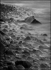B&W sea mist (Ally Mac) Tags: longexposure morning winter sea blackandwhite mist beach water rock stone sunrise canon dawn scotland rocks waves fife stones pebbles dysart kircaldy panha 40d