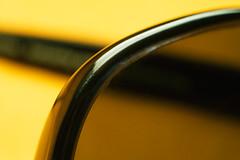 brown black macro reflection sunglasses yellow plastic frame worn scratch