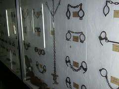 Wall of cuffs and leg irons (robotech_master_2000) Tags: museum handcuffs legirons sandyclark jmdavis