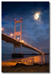 Severn Bridge moon (Roger.C) Tags: bridge sea england sky moon cold water wales night clouds canon river dark bravo motorway dusk severn 30d mywinners superbmasterpiece diamondclassphotographer flickrdiamond platinumheartaward