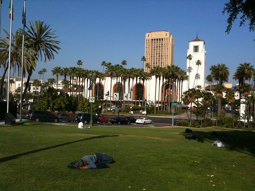 Union Station, with homeless people sleeping on the grass in the foreground