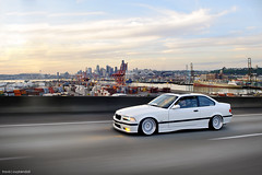 Nick (Travis Cuykendall) Tags: seattle sunset white motion classic skyline donna washington slam nikon space low nick clean alpine needle bmw pugetsound 28 1995 flush prima m3 rolling fit wolff slammed stance dumped 1755 portofseattle ccw d300 fitted westseattlebridge stanced