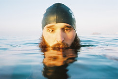 silent but deadly (lomokev) Tags: sea portrait sky selfportrait reflection male water hat sport swimming beard pier nikon brighton dof exercise kodak low kodakportra400vc depthoffield crisp westpier swimmer portra lomokev moring swimmingcap bsc kodakportra400 kodakportra deletetag nikonosv nikonos5 brightonswimmingclub artlibre artlibres flickr:user=lomokev flickr:nsid=40962351n00 file:name=071107nikonosvc110 thetheoryofmachines