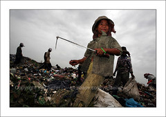 The garbage kids (yanseiler) Tags: travel trash work canon kid garbage cambodge cambodia poor dump bio bin pollution environment 5d phnompenh canon5d organic recycle stungmeanchey scaveng
