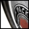 PACK... (Ralph Krawczyk Jr) Tags: red black metal digital silver typography automotive nikond50 rim hubcap ©allrightsreserved nikon28105mmf3545d rckrawczykjr ralphkrawczykjr packardprovinggrounds expdet123007 shelbytwpmichigan