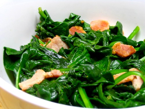 Wilted spinach with bacon bits