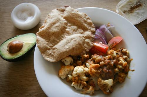 Chana masala, chapati and cauliflower with raita and avo