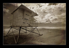 Tower Fly By (CameraOne) Tags: ocean california texture beach pelicans sepia clouds coast sand raw wideangle lifeguard pacificocean canon5d seashore keepoff flyby lifeguardtower firstaid morrobeach guardtower canon1740mm excapture