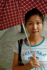 Shanghai Beauty (Rafal Bergman) Tags: china street portrait woman girl beautiful beauty umbrella pretty shanghai young mywinners abigfave