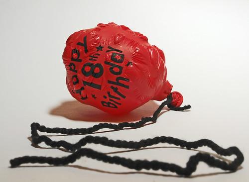 a deflated birthday balloon