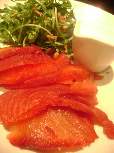 Salmon cured in vodka and beetroot served with rocket and walnut with horseradish frais