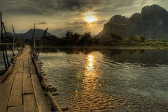 Vang Vieng in Laos (Maurizio Blasetti) Tags: bridge sun mountains river asia laos vangvieng sunfall nikon200 aplusphoto