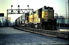 CNW GP-9's at Clybourn  station 1983 (Mark LLanuza) Tags: chicago yard north il ave cnw geeps