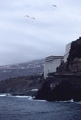 Paragliders in dull sky, Tenerife 2016 (arsenterzyan) Tags: eos5 canon film 35mm analog cloudy wind paragliders paraglide beach ocean travel tenerife