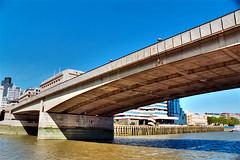 London Bridge, London (Thad Roan - Bridgepix) Tags: uk bridge blue england sky london water thames river concrete europe bridges 25 wikipedia 200409 span bridging bridgepixing bridgepix 02321