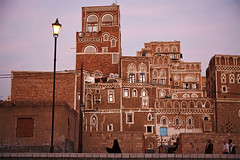 Twilight in the Old City - Sana'a, Yemen (Maciej Dakowicz) Tags: city travel people woman tourism town asia muslim islam unesco arabia historical yemen sanaa sana