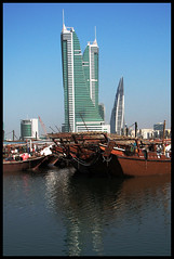 Building the new, forgetting the old (Fractal 00) Tags: new old white black color tower beach boat bahrain fishing artistic harbour landmarks financial versus
