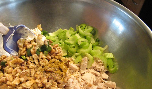 mixing chicken salad