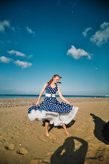 Dancing on the beach (.James.) Tags: blue sea sky woman color colour film beach beauty clouds 35mm belt shadows dress toycamera wide dancer polka dot redhead spotty isleofwight solent belle rockabilly 50s vivitar uws iow ryde plasticlens 22mm appley ultrawideandslim ultravivitar
