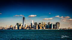 Manhattan Skyline (Riccardo Maria Mantero) Tags: hdr mantero ny newyork riccardo riccardomariamantero america blue city day empirestatebuilding landscape outdoors panorama skyline skyscraper unitedstates usa worldtradecenter