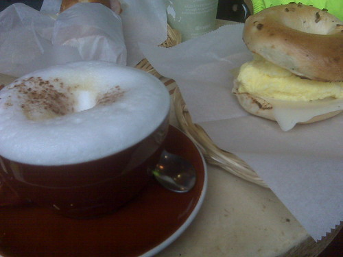 cappuccino and egg & cheese on an onion bagel for me