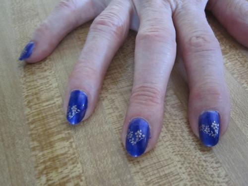 she said she feels like a witch. She tried my purple polish. She normally is a mauve wearer