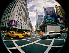outside penn station (sandcastlematt) Tags: street nyc newyorkcity newyork film lomo lomography fisheye macys empirestatebuilding gothamist 7thave 33rdstreet lomofisheye fisheye2 lomofisheye2