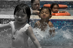 people - kids having fun (utpal.) Tags: life blue people bw india color green colors yellow clouds portraits canon landscape happy flickr child indian vivid assam picnik waterscape chandana utpal utpalnath