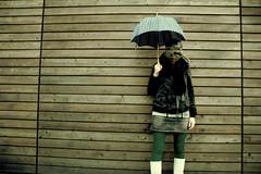 scene 4 (madochab) Tags: people urban woman girl hat fashion female trash umbrella neon alone dress boots wand victim posing struktur depression frau mode holz dressed mtze mdchen leder verlassen einsam gefahr hintergrund kleidung steht mado hilfe minirock stiefel regenschirm traurig klamotten weiblich grtel stehen schutz allein alleine schtzen leggins deprimiert