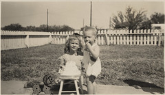 My Sister's First Birthday 1944 #2 (Photo_History - Here but not Happy) Tags: birthday birthdaycake firstbirthday woodenhorse pulltoy sunsuit tacomaartmuseum