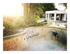 Old Skool Fool Pool (mallix) Tags: africa old light sunset house abandoned pool vertical wall swimming graffiti high ruins ride deconstruct empty tag south skating capetown bowl vert beam drain swimmingpool urbanexploration skate flare skateboard spraypaint worldcup 1980 bushes derelict oldskool section wallride secretspot 2010 urbex soccerworldcup worldcup2010 fifa2010 oldfool urbexsa